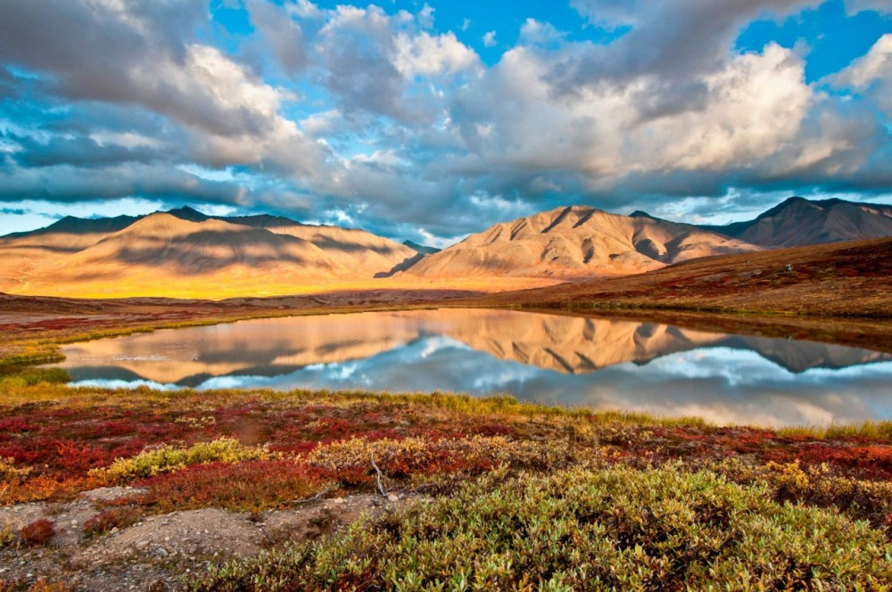 At Gates of the Arctic National Park and Preserve in Alaska, wild rivers meander through glacier-carved valleys, caribou migrate along age-old trails and endless summer light fades into aurora-lit night skies of winter. Pictured here is a beautiful mountain vista near Anaktuvuk Pass in the Brooks Range. Photo by Carl Johnson. Posted on Tumblr by the US Department of the Interior, 5/14/15.
