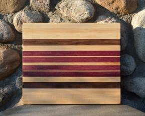 "Cutting Board 15 - 048. Hard Maple, Black Walnut and Purpleheart edge grain. 13"" x 15"" x 1-1/4"". Sold at its first showing."