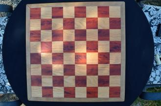 Ches Board # 04. Padauk & Honey Locust Squares with a Cherry Border. Note that the orange Padauk will change over time - particularly with UV exposure - and will end up a nice warm brown.