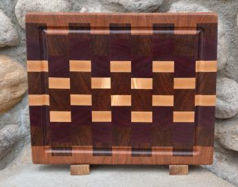 "Cutting Board # 15 - 052. Cherry, Black Walnut, Jatoba, Purpleheart and Hard Maple end grain with juice groove. Absolutely unique grain in the hard maple. 12"" x 16"" x 1-1/2""."