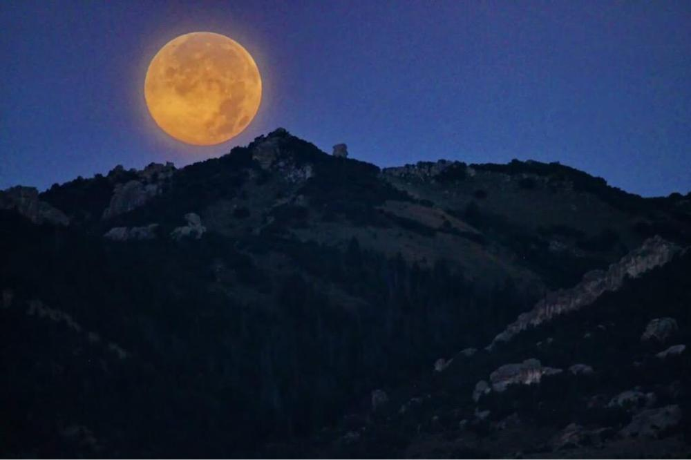 """The """"blue moon"""" as seen from the City of Rocks National Monument. Tweeted by the US Department of the Interior, 8/1/15."""