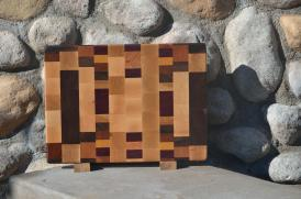 "Cutting Board # 15 - 048. Hard Maple, Black Walnut, Cherry, Jatoba, Honey Locust, Purpleheart & Yellowheart. Mixed Grain. 11"" x 15"" x 1""."