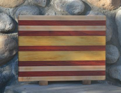 "Cutting Board # 15 - 069. Hard Maple, Padauk & Yellowheart. Edge grain. 12"" x 16"" x 1-1/4""."