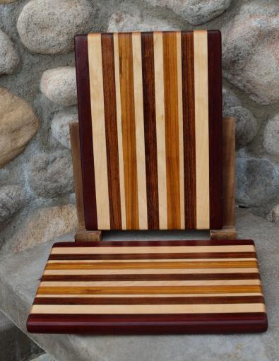 "Cheese Board # 15 - 028. Black Walnut, Hard Maple, Jatoba & Canarywood. Edge Grain. 8"" x 11"" x 3/4""."