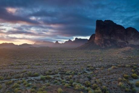 The 97,880-acre Eagletail Mountains Wilderness is about 65 miles west of Phoenix, Arizona, in Maricopa, Yuma and LaPaz counties. The wilderness includes 15 miles of the Eagletail Mountains ridgeline and Courthouse Rock to the north, Cemetary Ridge to the south, and a large desert plain area between the two ridgelines. Several different rock strata are visible in most places with natural arches, high spires, monoliths, jagged sawtooth ridges and numerous washes six to eight miles long. Recreation such as extended horseback riding and backpacking trips, sightseeing, photography, rock climbing and day hiking are enhanced by the topographic diversity, scenic character, size – as well as the botanical, wildlife, and cultural values of the area. Photo by Bob Wick. Tweeted by the U Department of the Interior, 9/8/15.