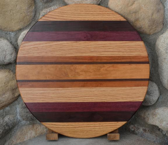 "Lazy Susan # 15 - 019. Red Oak, Black Walnut, Purpleheart, Cherry & Hard Maple. 17"" diameter x 3/4""."