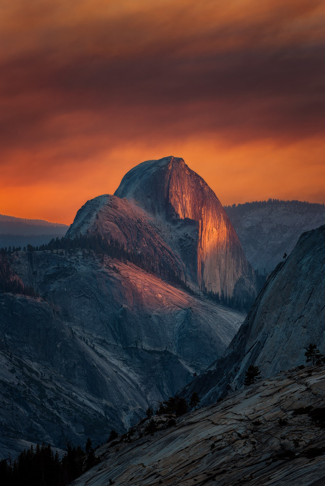 Sunset turns the sky orange at Yosemite National Park in California, illuminating Half Dome. Photo of courtesy of Aron Cooperman. Posted on Tumblr by the US Department of the Interior, 9/13/15.