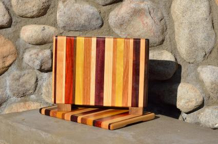 "Cheese Board # 15 - 031. Black Walnut, Hard Maple, Bloodwood, Red Oak, Yellowheart, Cherry, Purpleheart & Padauk. Edge grain. 9"" x 10"" x 3/4""."