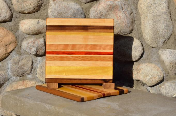 "Cheese Board # 15 - 032. Balck Walnut, Hard Maple, Yellowheart, Cherry & Padauk. Edge grain chaos board. 9-1/2"" x 9-1/8"" x 5/8""."