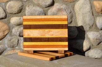 "Cheese Board # 15 - 033. Hard Maple, Canarywood, Yellowheart & Black Walnut. Edge grain. 11-1/2"" x 9"" x 3/4""."