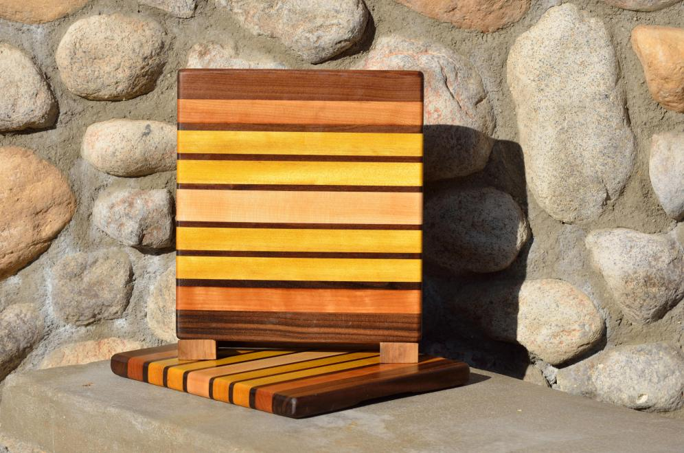 "Cheese Board # 15 - 037. Black Walnut, Cherry, Yellowheart & Hard Maple. Edge grain. 10-3/4"" x 9-3/4"" x 3/4""."