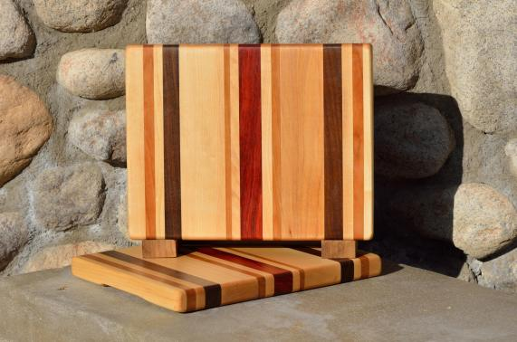 "Cheese Board # 14 - 040. Hard Maple, Cherry, Black Walnut & Padauk. Edge grain chaos board. 11"" x 8-1/2"" x 3/4""."