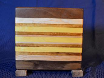 "Cheese Board # 15 - 050. Black Walnut, Hard Maple, Cherry & Yellowheart. Edge Grain. 8"" x 10"" x 3/4""."
