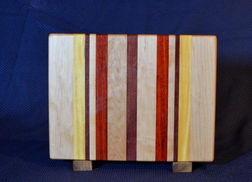 "Cutting Board # 15 - 106. Hard Maple, Yellowheart, Purpleheart & Padauk. Edge Grain. 10"" x 12"" x 1-1/4""."