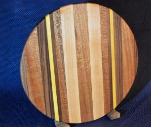 """Lazy Susan # 15 - 027. Black Walnut, Mahogany, Yellowheart & Hard Maple. 17"""" diameter x 3/4"""". The Mahogany has a hint of turquoise in it!"""