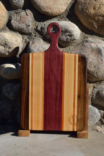 "Sous Chef # 15 - 51. Black Walnut, Hard Maple, Cherry & Purpleheart. 9"" x 16"" x 3/4""."