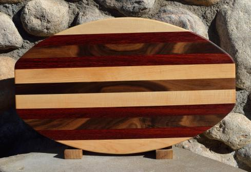 "Surfboard # 15 - 36. Hard Maple, Padauk & Black Walnut. 12"" x 19"" x 1-1/4"". Sold in its first showing."