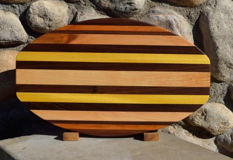 "Surfboard # 15 - 42. Black Walnut, Cherry, Hard Maple & Yellowheart. 12"" x 19"" x 1-1/4""."
