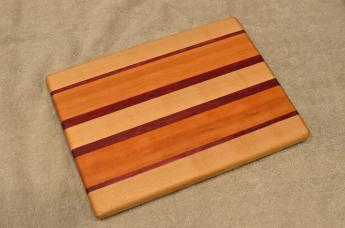 "Cheese Board # 15 - 051. Hard Maple, Purpleheart & Cherry. 8"" x 11"" x 3/4""."