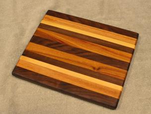 "Cheese Board # 15 - 052. Black Walnut, Cherry, Hard Maple & Canarywood. 8"" x 10"" x 3/4""."