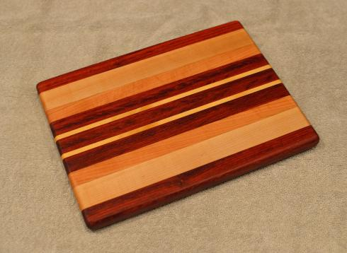 "Cheese Board # 15 - 056. Black Walnut, Hard Maple, Cherry. 8"" x 11"" x 3/4""."