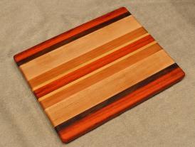 "Cheese Board # 15 - 060. Padauk, Black Walnut, Hard Maple & Cherry. 8"" x 11"" x 3/4""."