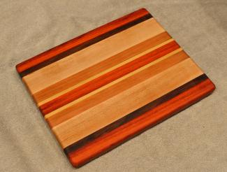"Cheese Board # 15 - 060. Padauk, Black Walnut, Hard Maple & Cherry. 8"" x 11"" x 3/4""."