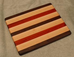 "Cheese Board # 15 - 061. Black Walnut, Hard Maple & Padauk. 8"" x 11"" x 3/4""."