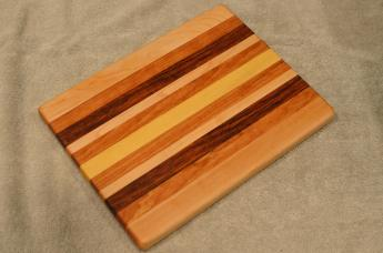 "Cheese Board # 15 - 066. Hard Maple, Jatoba, Black Walnut, Yellowheart & Cherry. 8"" x 11"" x 3/4""."