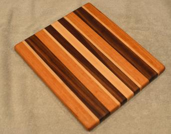 "Cheese Board # 15 - 067. Cherry, Hard Maple & Black Walnut. 9"" x 11"" x 3/4""."
