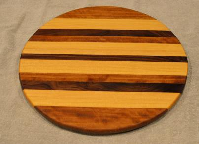 "Lazy Susan # 15 - 044. Teak, Yellowheart & Black Walnut. 17"" diameter x 3/4""."