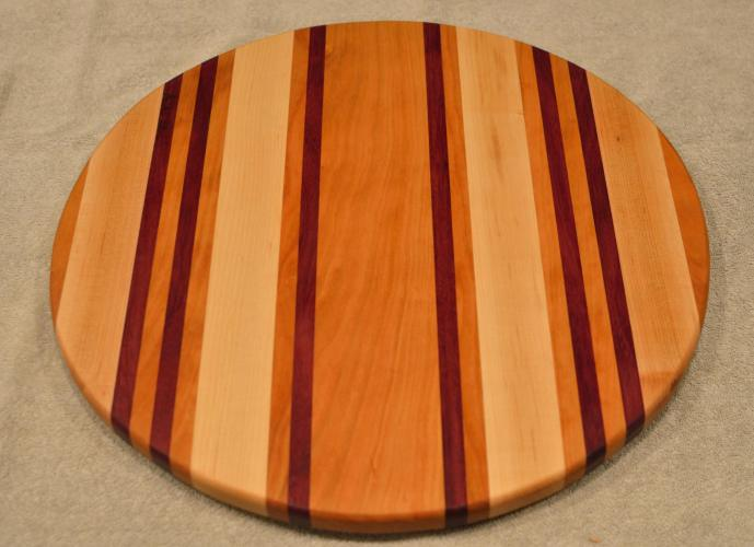 "Lazy Susan # 15 - 048. Cherry, Hard Maple & Purpleheart. 17"" diameter x 3/4""."