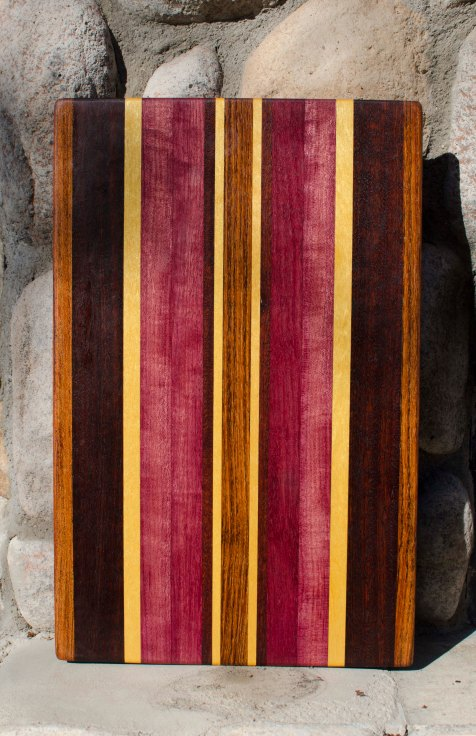 "Cutting Board 15 - 094. Jatoba, Black Walnut, Yellowheart, Jarrah, & Jatoba. 13"" x 19"" x 1-1/2"". Commissioned piece; replacement board fitted in a counter top."