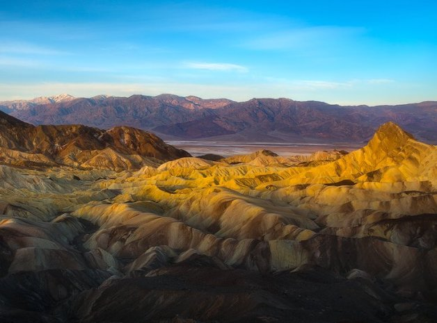 A colorful landscape greets the day in Death Valley. Photo taken from Zabriskie Point. Photo by Scotty Perkins. Tweeted by the US Department of the Interior, 1/24/16.