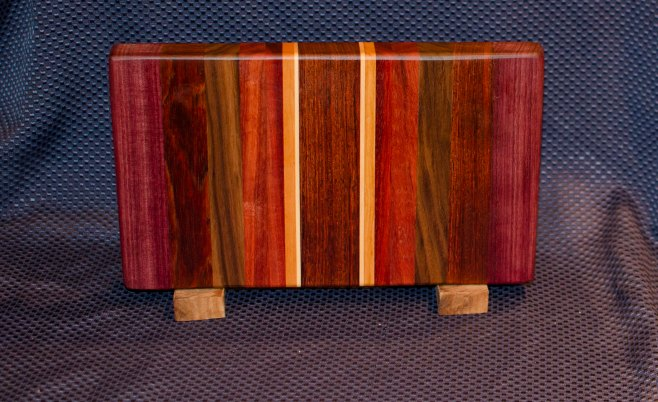 "Small Board 16 - 004. Purpleheart, Jatoba, Padauk, Black Walnut, Cherry, Hard Maple & Jarrah. 7"" x 12"" x 1-1/4""."