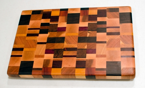 "Cutting Board 16 - End 002. Chaos board. Cherry, Hard Maple, Purpleheart, Jatoba, Black Walnut, Yellowheart, Padauk, Burmese Teak, Hickory & Bloodwood. End grain. 10"" x 14"" x 1""."