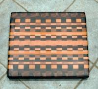 "Cutting Board 16 - End 011. Chaos board. Black Walnut, Padauk, Yellowheart, Cherry, Jatoba, Hard Maple, Bloodwood, Canarywood. End grain. 15"" x 17"" x 1-3/8""."