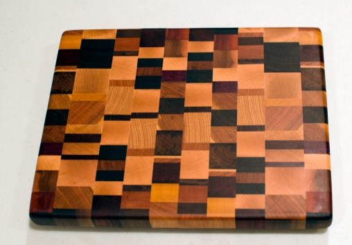 "Small Board 16 - 004. Black Walnut, Cherry, Hard Maple, Purpleheart, Burmese Teak, Yellowheart, Purpleheart, Padauk & Hickory. End Grain. 10"" x 12"" x 1""."