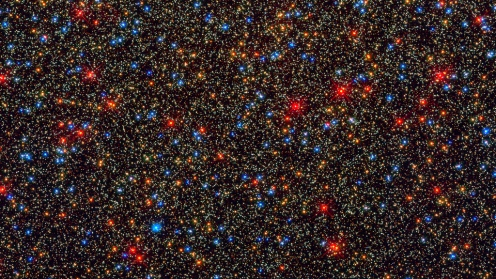 Omega Centauri Hubble snapped this view of a colorful assortment of 100,000 stars residing in the crowded core of a giant star cluster. The image reveals a small region inside the massive globular cluster Omega Centauri, which boasts nearly 10 million stars. Globular clusters, ancient swarms of stars united by gravity, are the homesteaders of our Milky Way Galaxy. The stars in Omega Centauri are between 10 billion and 12 billion years old. Photo by the Hubble Telescope.