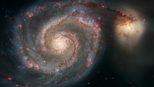 Whirlpool Galaxy and Companion The graceful, winding arms of the majestic spiral galaxy M51 (NGC 5194) appear like a grand spiral staircase sweeping through space. They are actually long lanes of stars and gas laced with dust. Some astronomers believe that the Whirlpool's arms are so prominent because of the effects of a close encounter with NGC 5195, the small, yellowish galaxy at the outermost tip of one of the Whirlpool's arms. Photo from the Hubble Telescope.