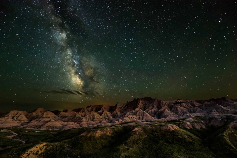 Bathed in starlight from the Milky Way, the unique rock formations of Badlands National Park in South Dakota glow in the darkness. The ancient landscape and fascinating fossil beds make this place seem timeless. This stunning photo was the winner in the night sky category of the Share the Experience photo contest, which gives amateur photographers the chance to showcase their skills by capturing the beauty of the nation's public lands. Photo by Erik Fremstad. Posted on Tumblr by the US Department of the Interior, 4/30/16.
