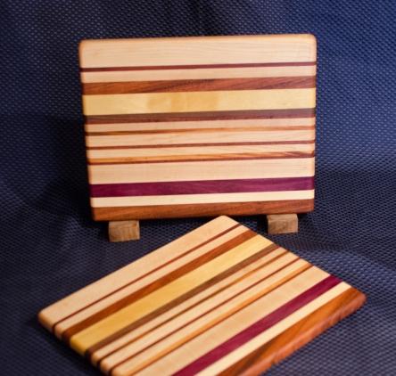 "Cheese Board 16 - 006. Edge Grain. Hard Maple, Jatoba, Yellowheart, Goncalo Alves, Black Walnut & Purpleheart. 8"" x 11"" x 3/4""."