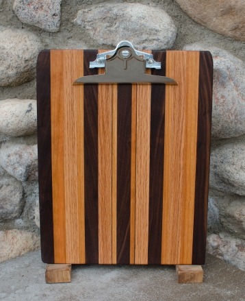 "Clipboard 16 - 005. Black Walnut, Red Oak & Cherry. Letter size. 1"" capacity clip."