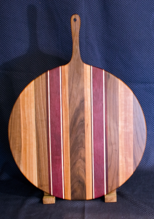 "Pizza Server 16 - 01. Black Walnut, Cherry, Purpleheart & Hard Maple. 17"" disc w/ 6"" handle, 3/4"" thick."