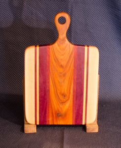 "Sous Chef 16 - 008. Hard Maple, Bloodwood, Purpleheart & Canarywood. 9"" x 12"" work surface & 4"" handle."