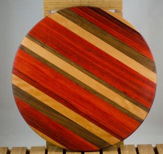 "Lazy Susan 16 - 012. Cherry, Bloodwood, Padauk & Black Walnut. 17"" diameter x 3/4""."