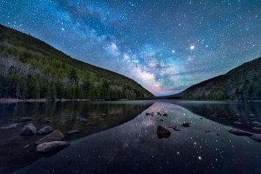 The Milky Way sparkles over Bubble Pond at Maine's Acadia National Park. Photo by Evan Kokoska. Tweeted by the US Department of the Interior, 5/16/16.