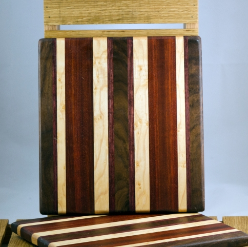 "Cheese Board 16 - 022. Black Walnut, Bubinga, Bloodwood & Birdseye Maple. 9"" x 11"" x 3/4""."