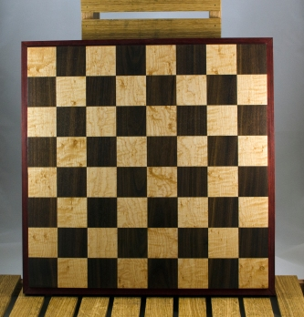 "Chess 16 - 02. Birdseye Maple & Walnut playing surface framed in Padauk. Squares are 2-1/8"" across."