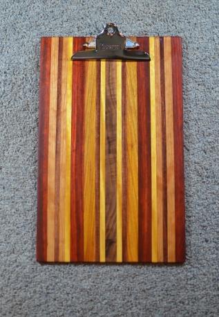 "Clipboard 16 - 015. Padauk, Red Oak, Yellowheart, Cherry & Canarywood. Legal size, 1"" clip."